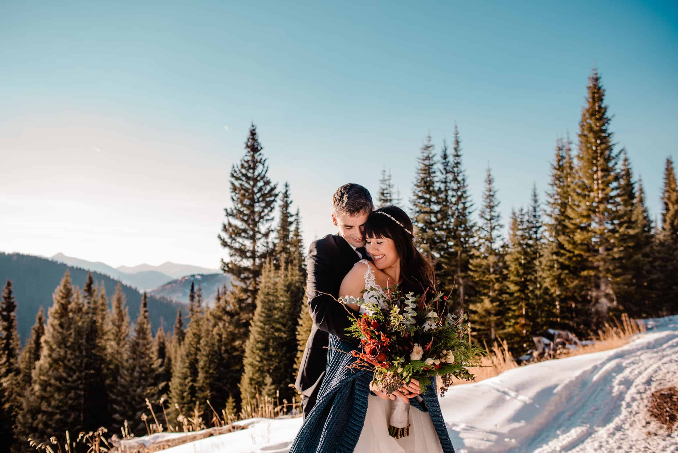 couple standing in snow during their Colorado winter elopement