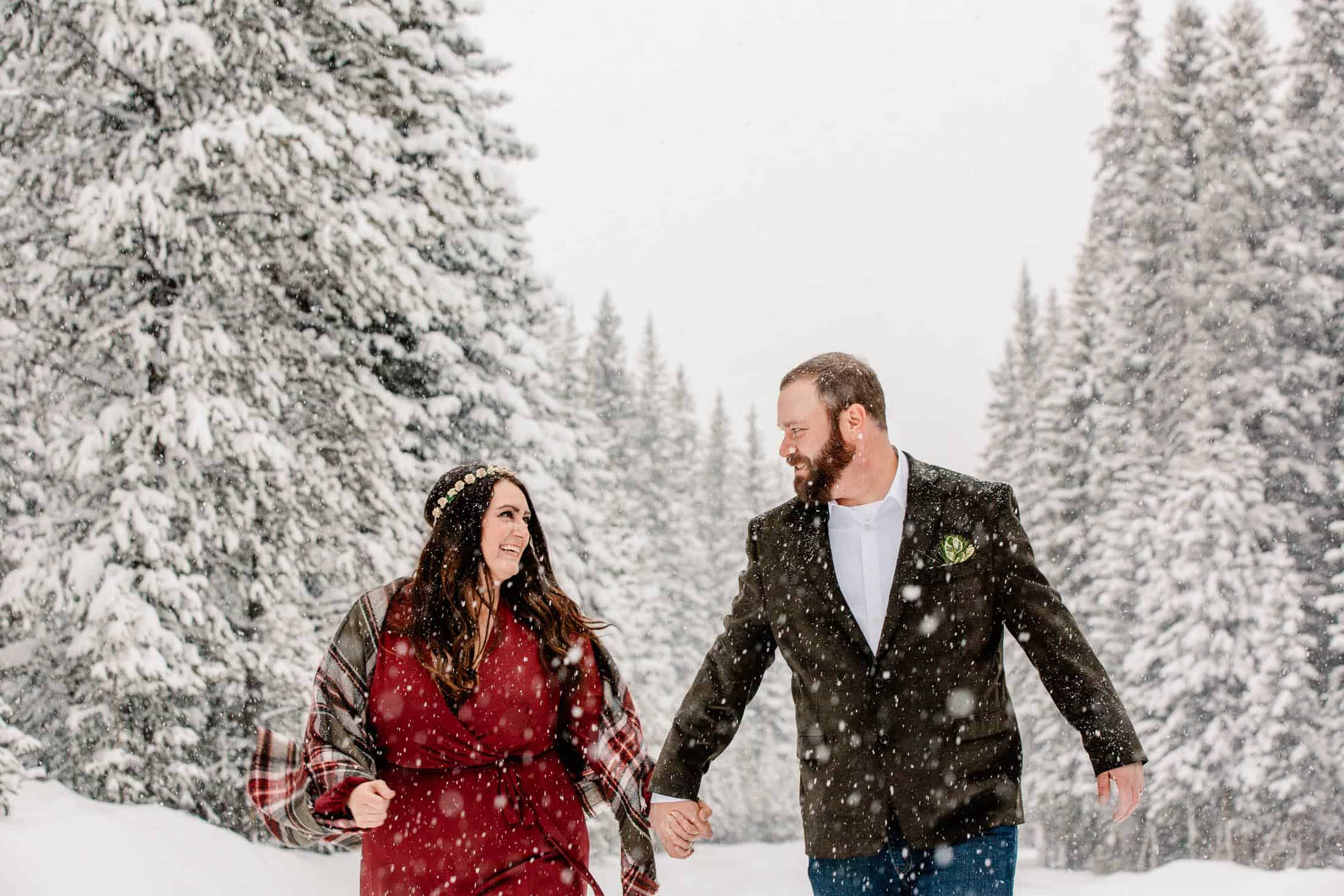 couple walking through the snow during their Colorado winter elopement