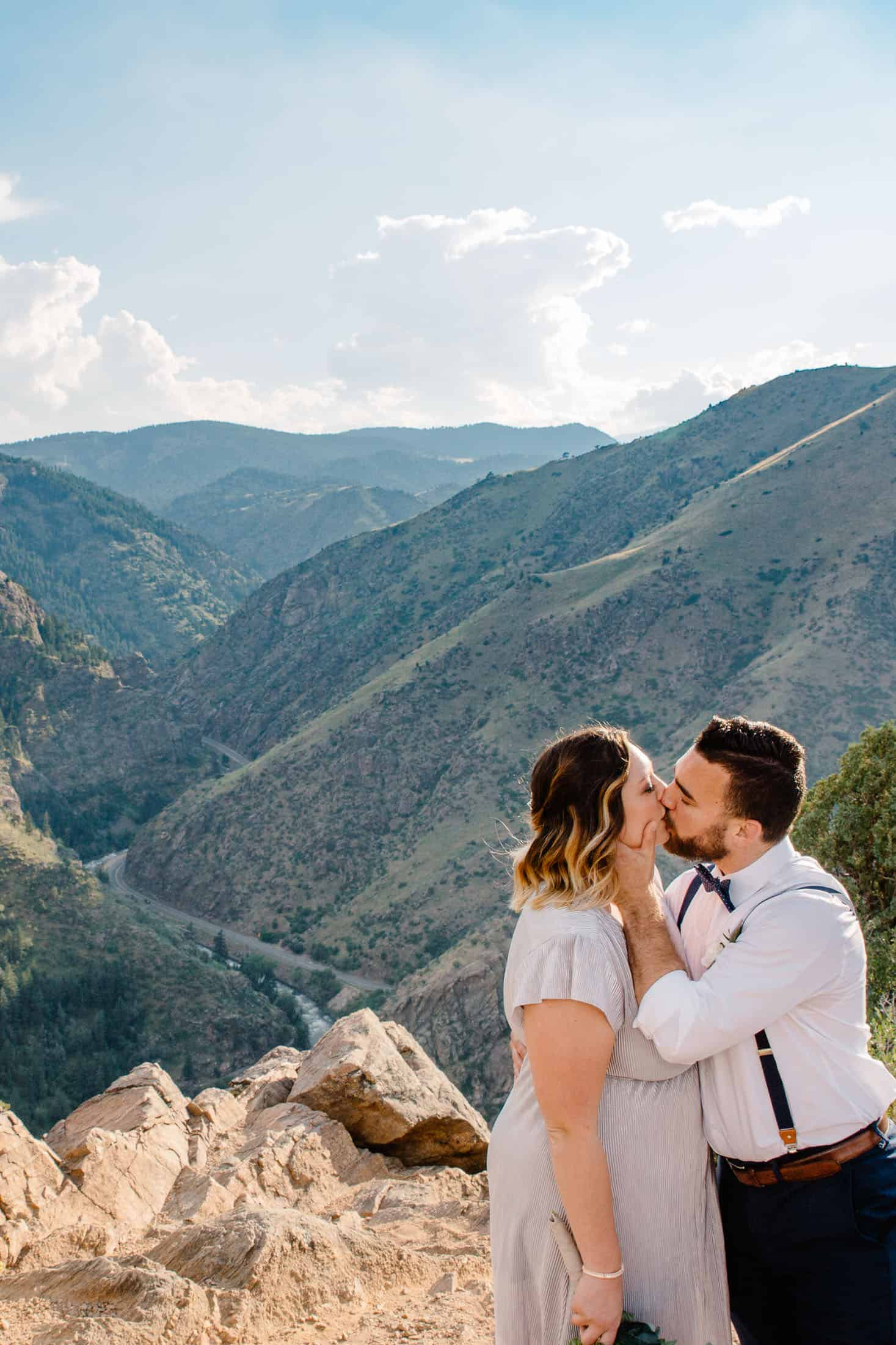 couple kissing on the top of the mountain after deciding on the best places to elope in Colorado was golden for them!