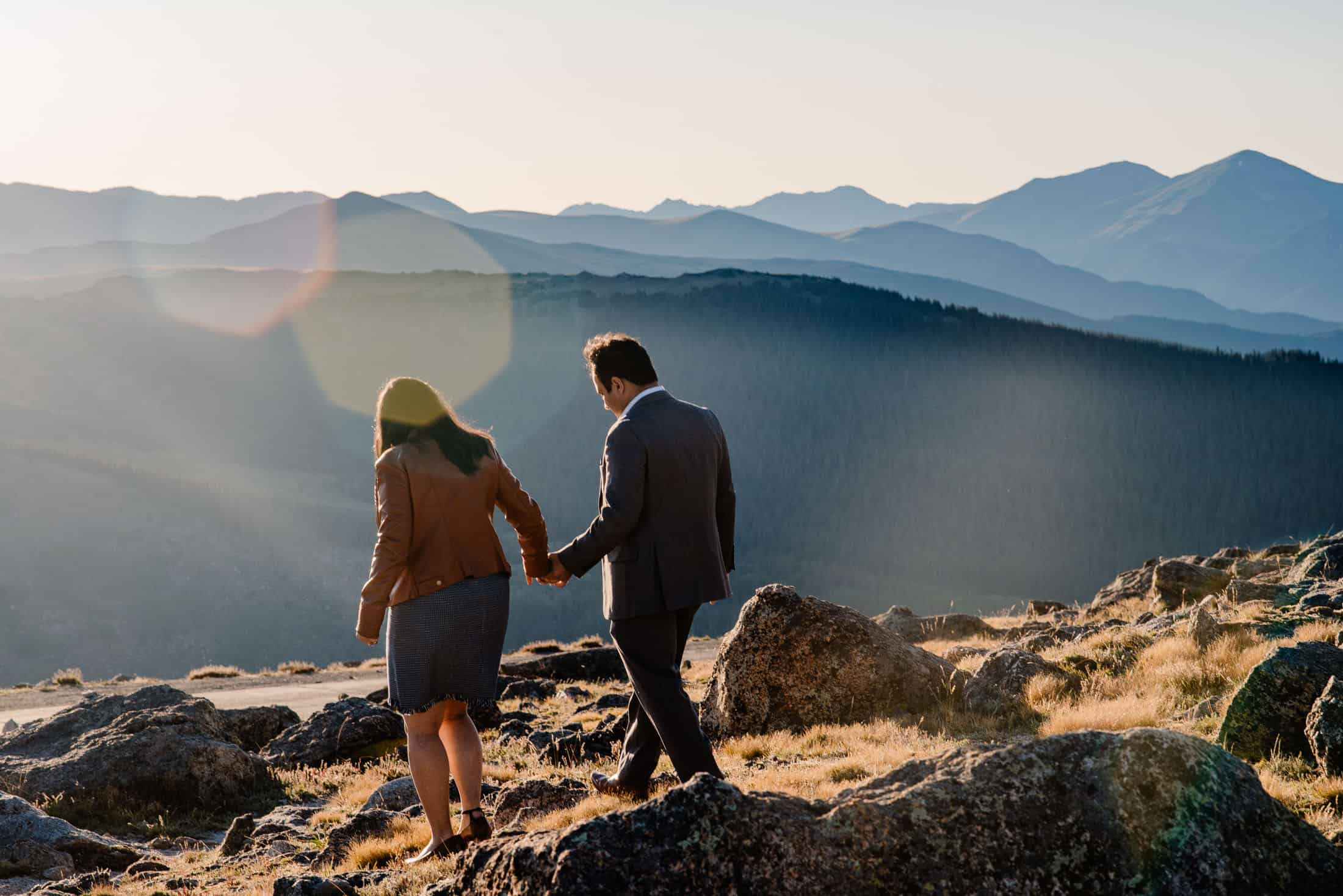 couple walking hand in hand exploring the best places to elope in Colorado before their wedding day