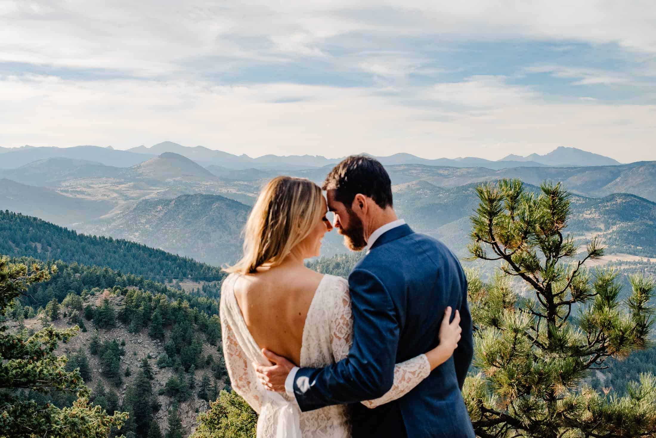 couple facing each other as they overlook one of the best places to elope in colorado