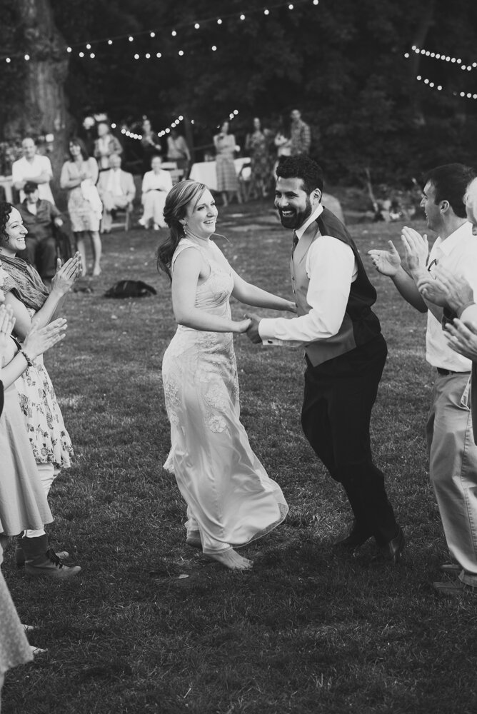 bride and groom dancing having a party