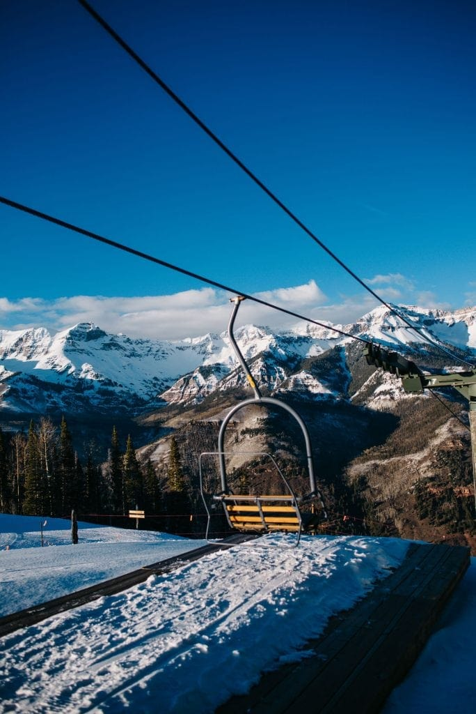 Ski lift in the winter time in Telluride, Colorado with mountains snow capped in the background