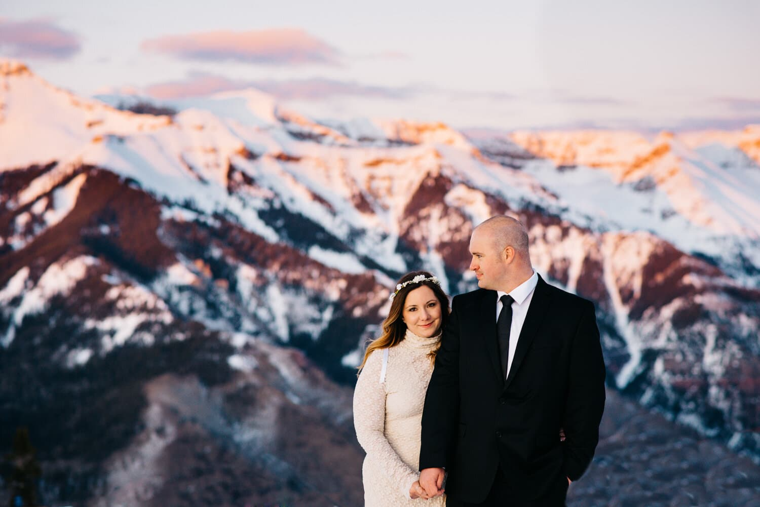 couple standing on a mountain top on their colorado elopement wedding day