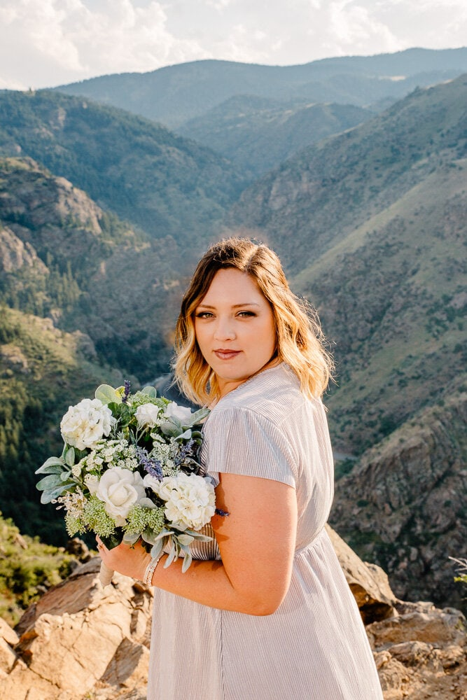 bride smiling at camera on mountain top