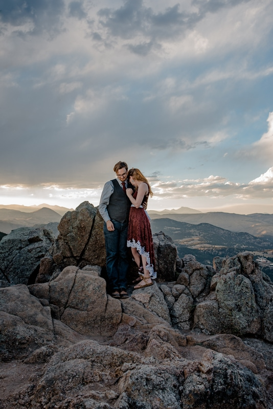 eloping couple standing on the top of lost gulch overlook in boulder colorado as boulder elopement photographer takers their photo