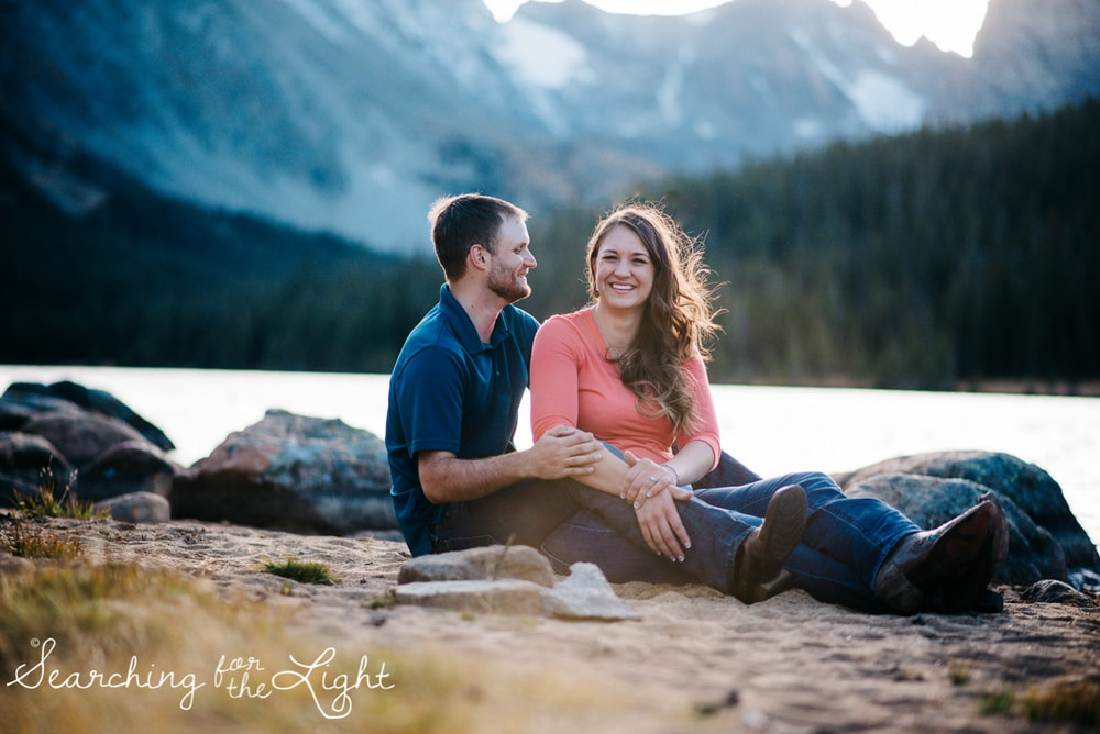 couple near long lake in brained rec center taking engagement photos