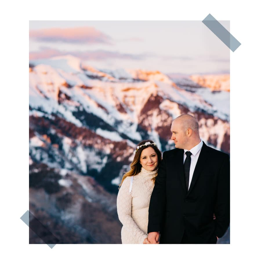 couple on mountain top at sunset