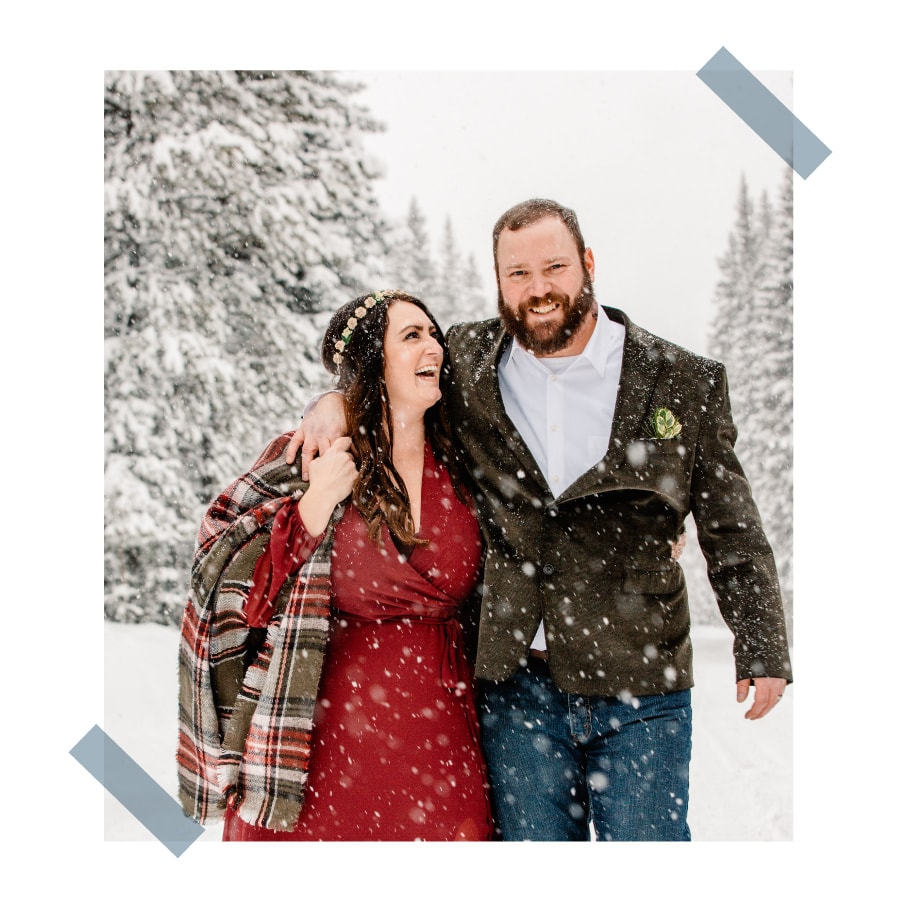 couple in a snow storm smiling