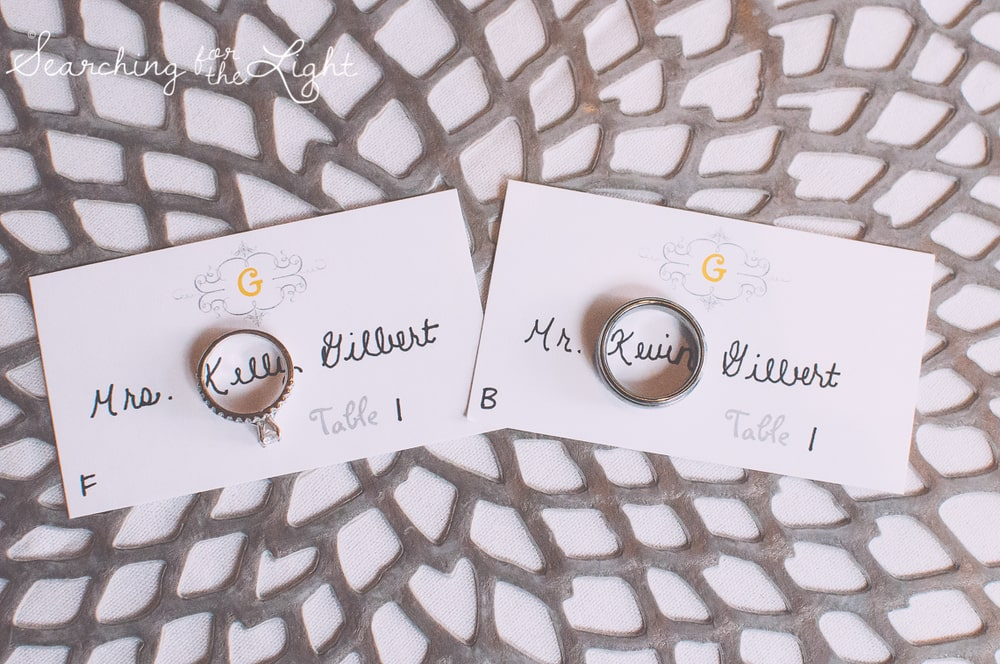 wedding rings creative photo using escort cards and table placemats