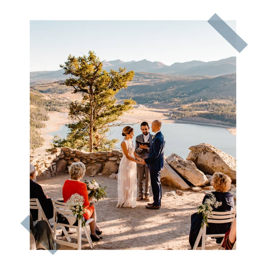Couple getting married at Sapphire Point in Colorado while their Colorado elopement photographer takes their picture during their ceremony