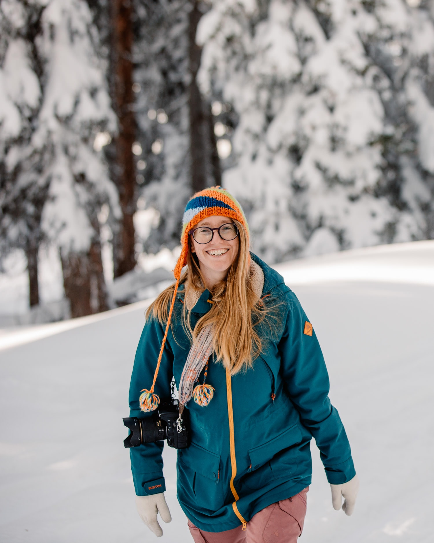 Photo of Emmy in burton snowsuit