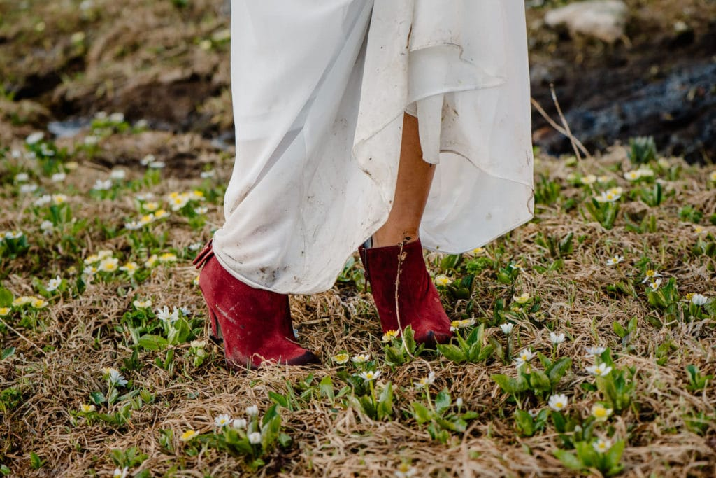 high heels in dirt with dirt on bottom of a white dress