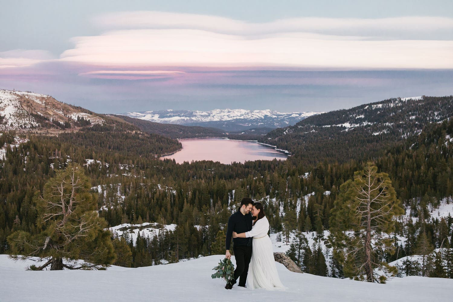 couple in snow on a mountain top
