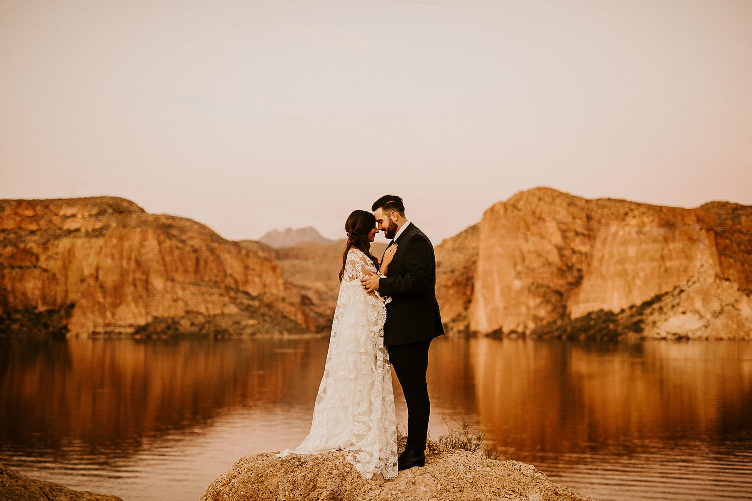 couple near a desert lake content because they decided on the best places to elope