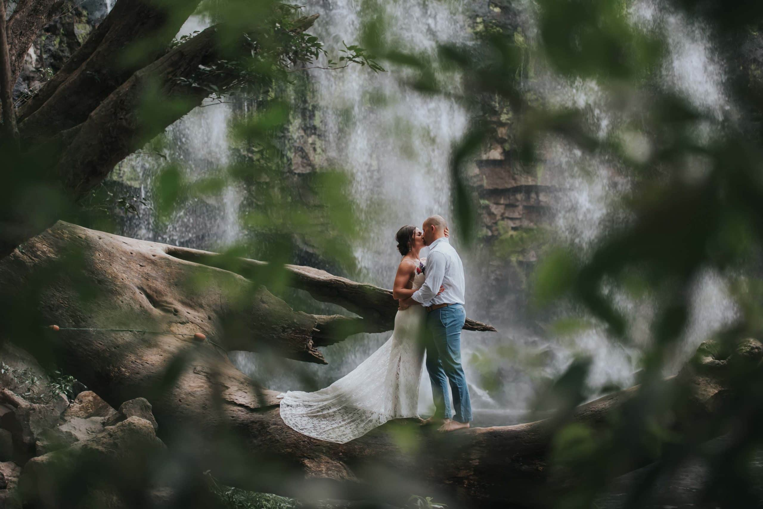 couple near a waterfall content because they decided on the best places to elope