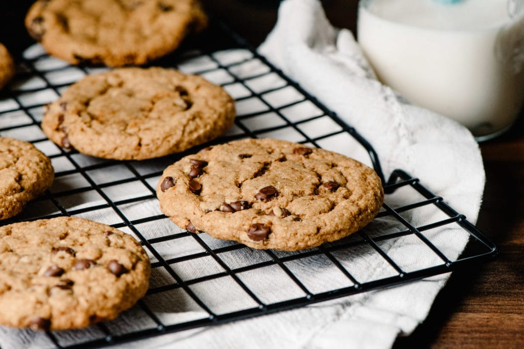 best vegan grain free chocolate chip cookies on a tray with milk in the background