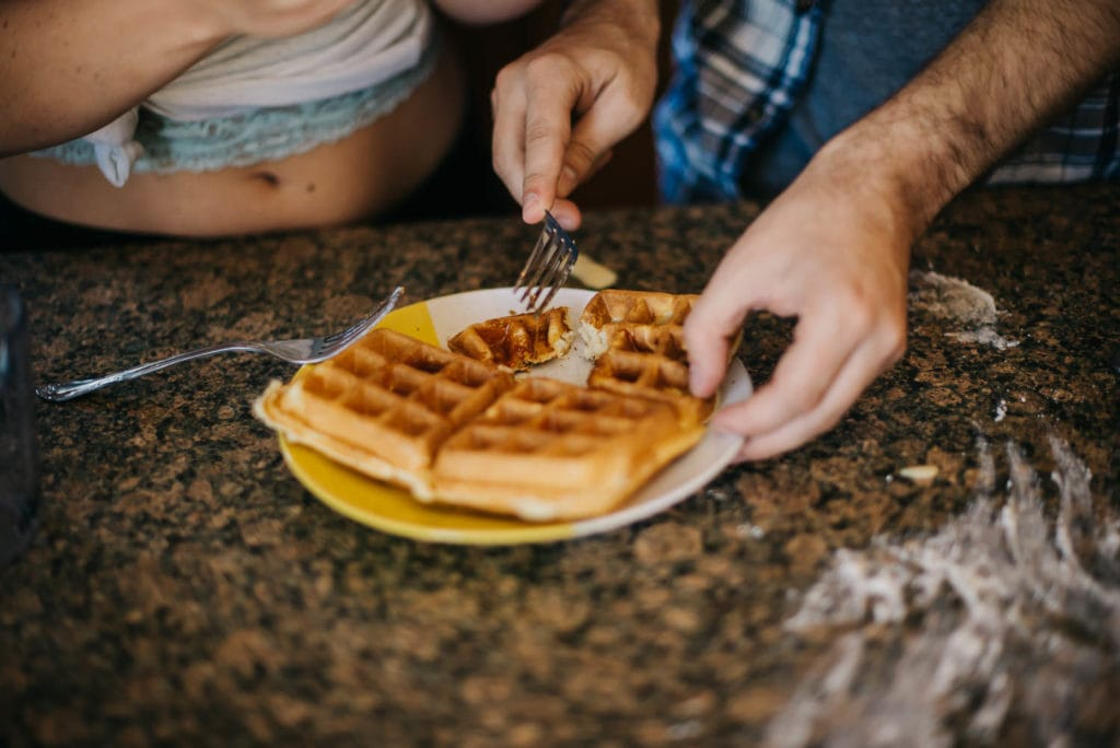 Couple eating a waffle together they cooked