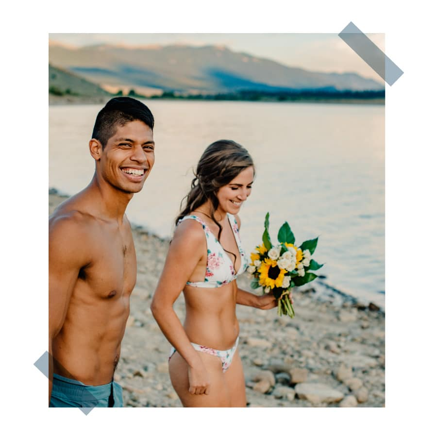 couple walking down to the water smiling at their Oregon elopement photographer