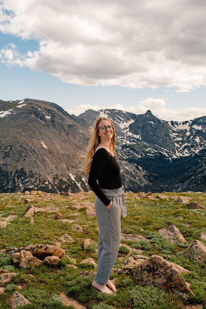 photo of emmy standing barefoot on a mountain top