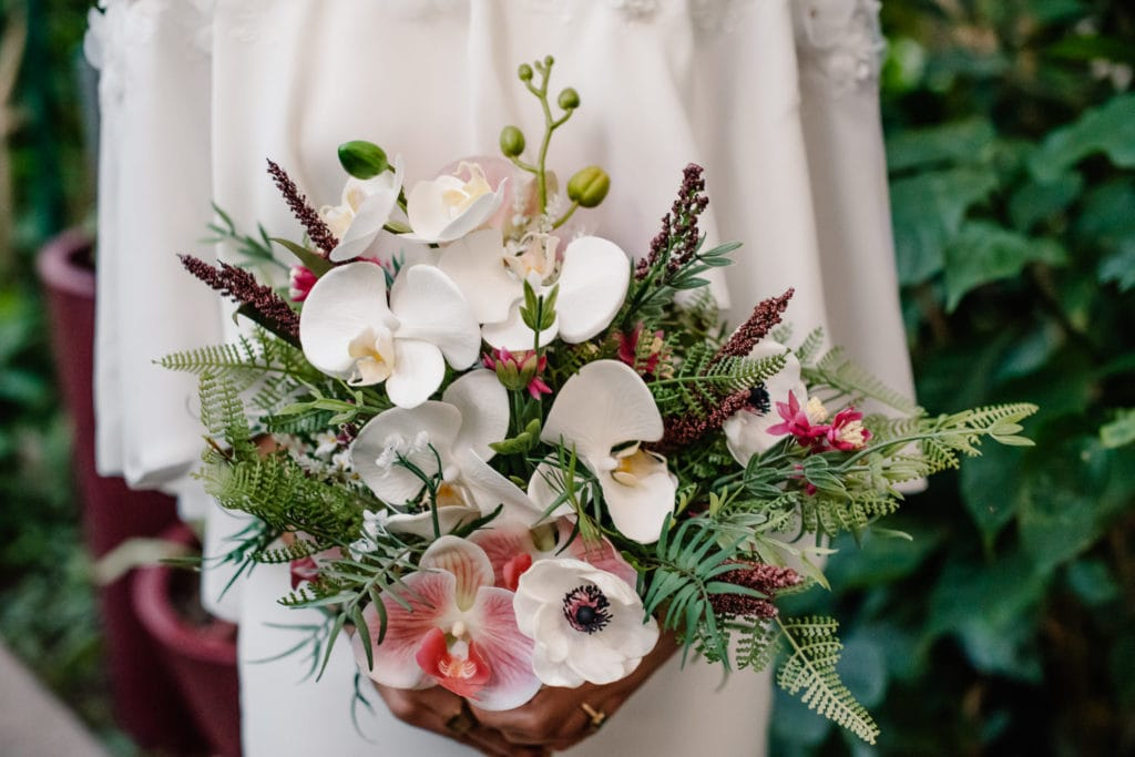 bride holding silk flowers