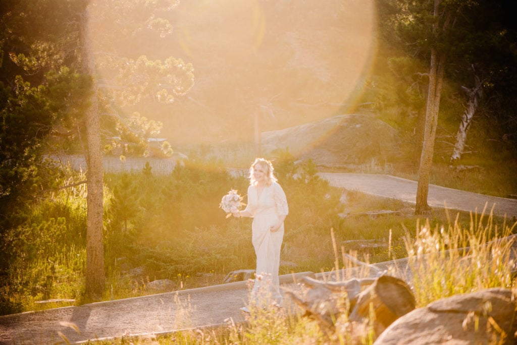 bride walking during golden hour at sprague lake