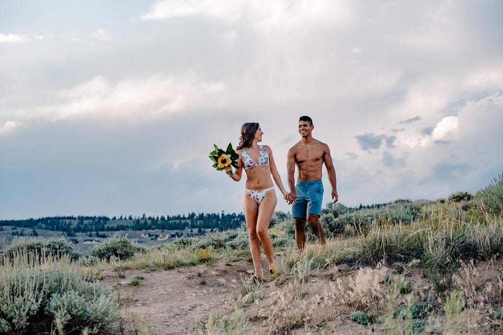 couple swimming on elopement day
