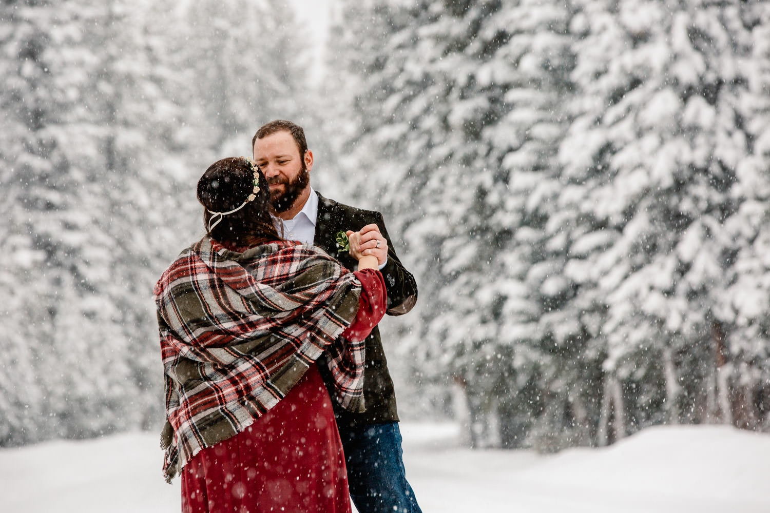 couple dancing in the snow in winter