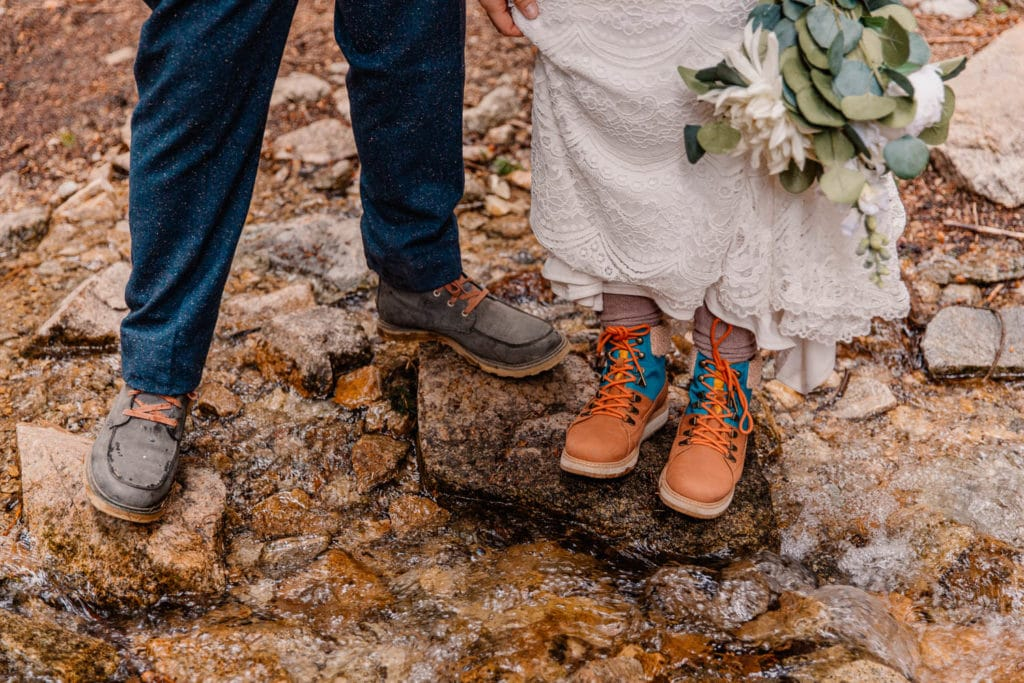 couple on their wedding day showing their shoes