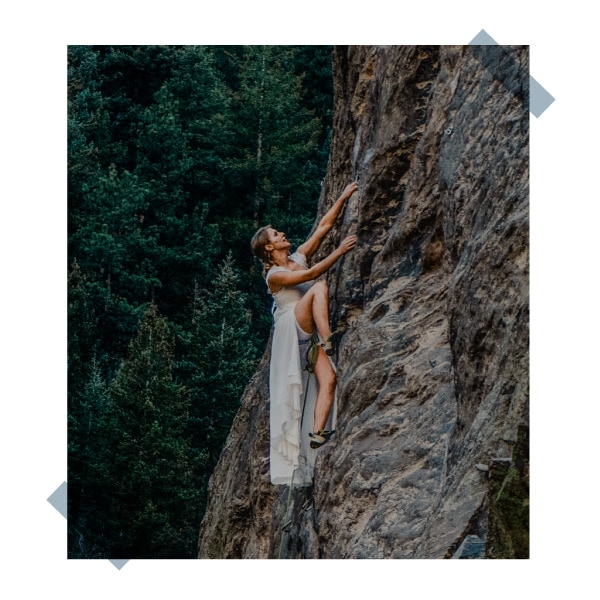 bride rock climbing on her adventure elopement