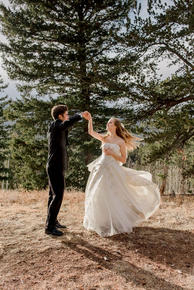 bride being twirl by her new spouse in ball gown wedding dress