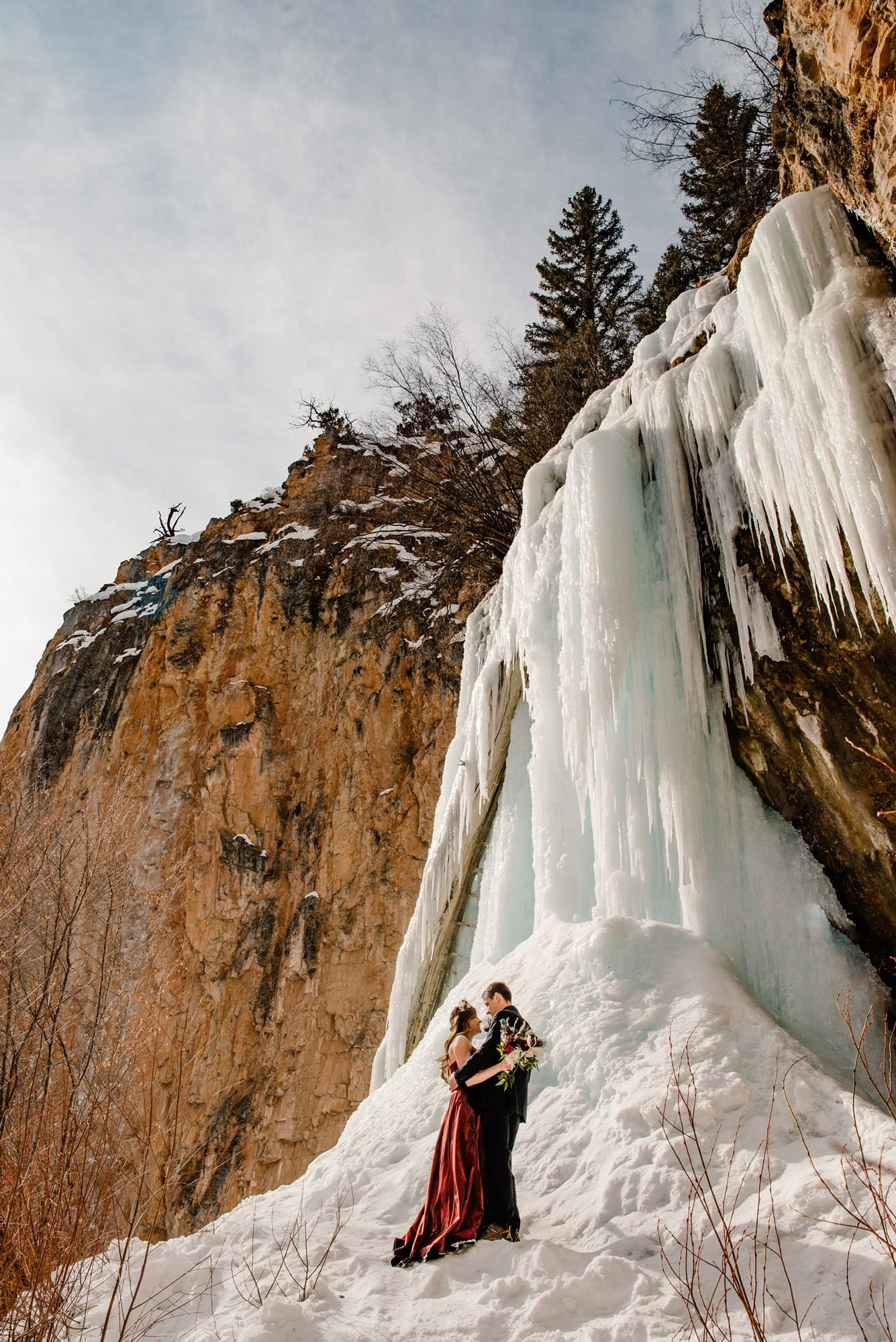couple in front of an ice cave