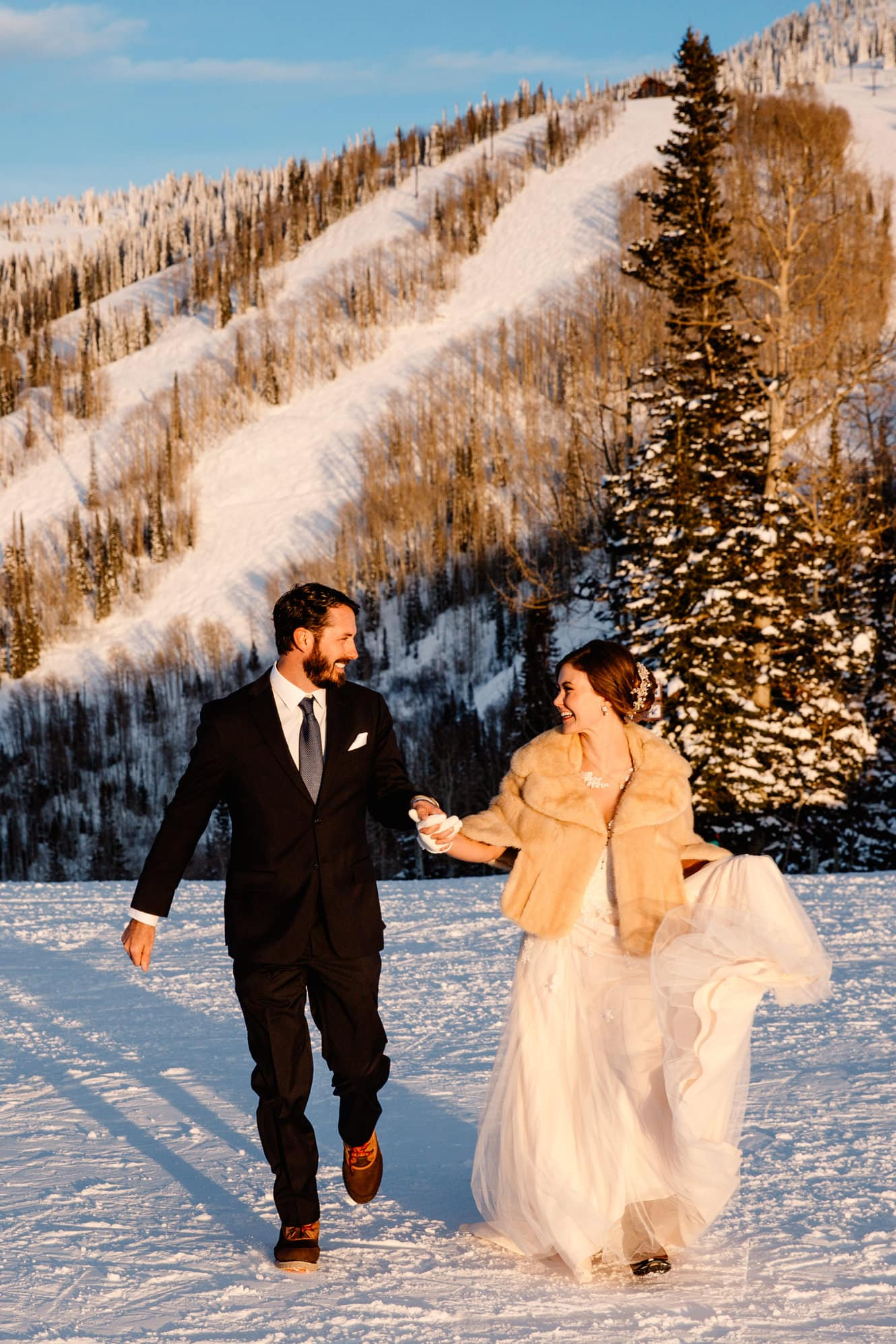 couple on a ski hill as they just eloped in colorado