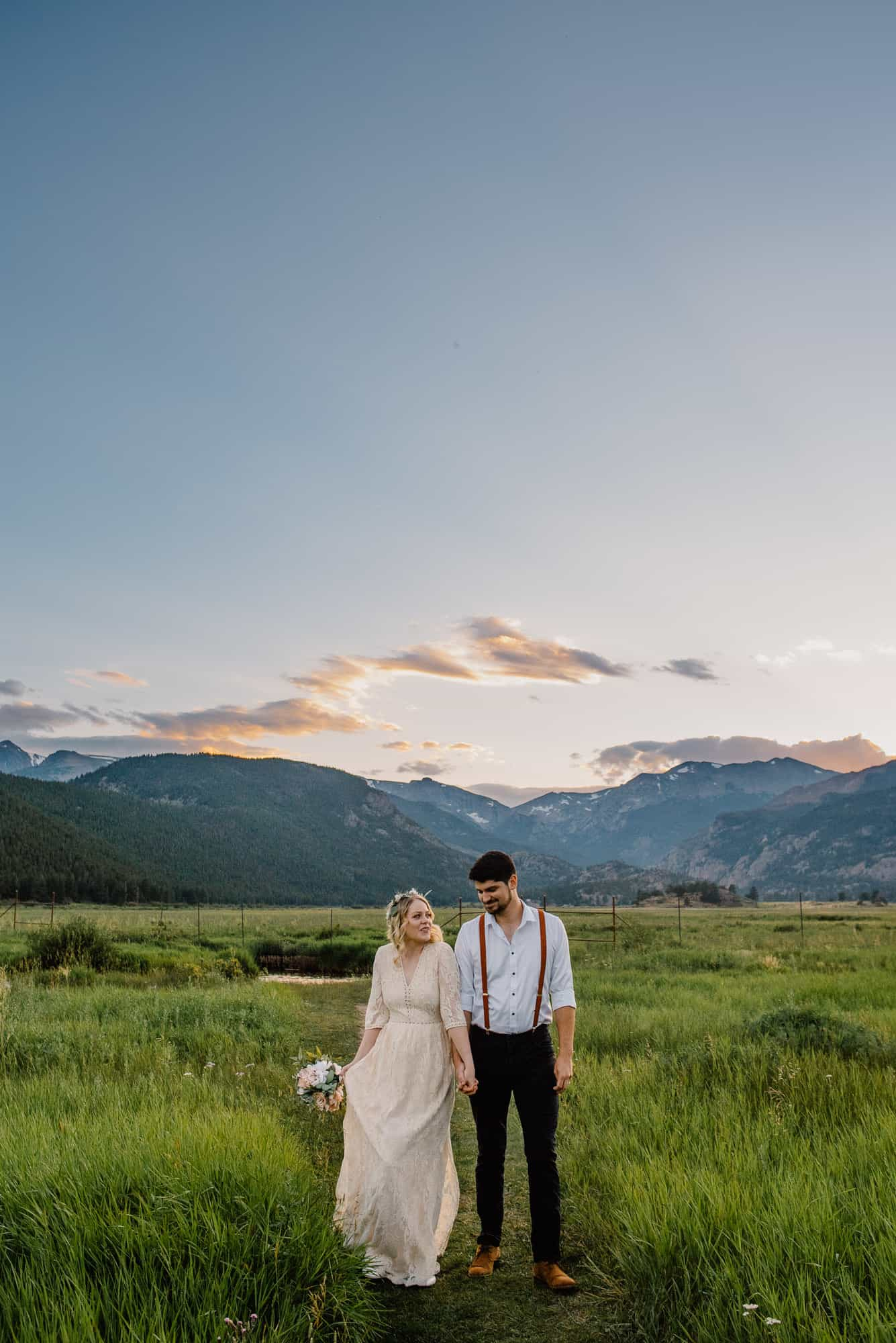 couple at their rocky Mountain national park wedding smiling together in a field