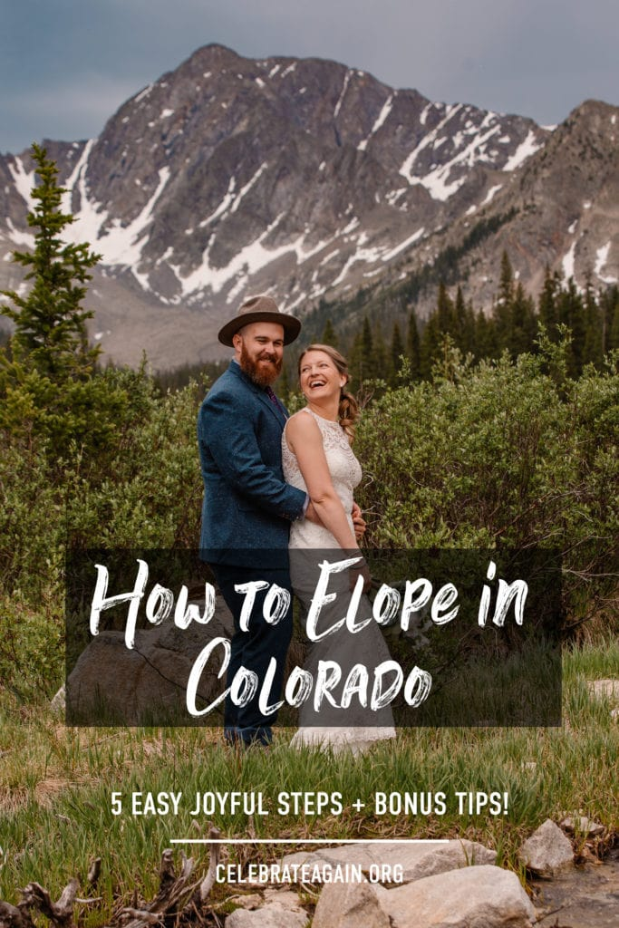 couple smiling at each other as they elope in colorado