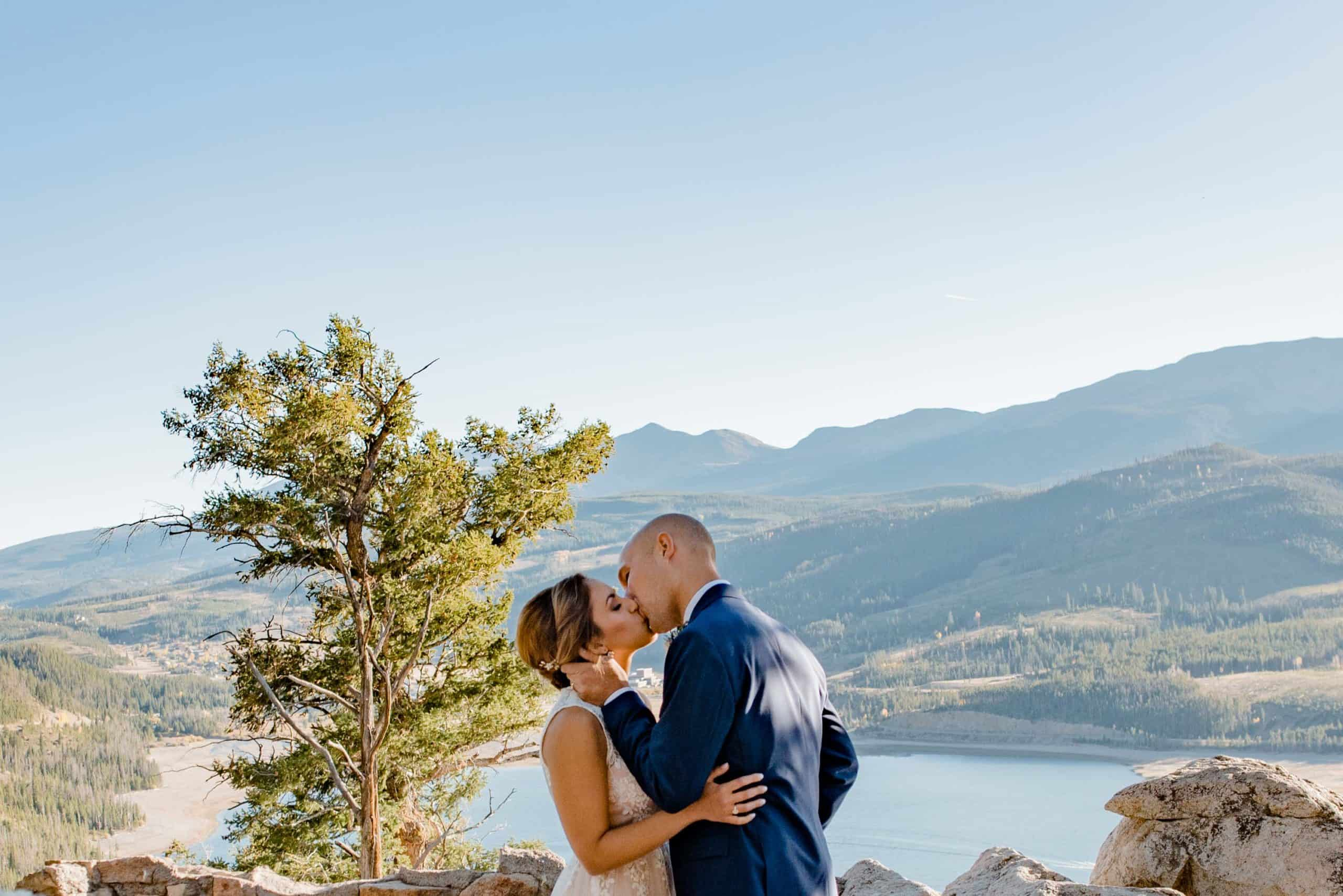 couple kissing after the Breckenridge elopement locations wedding