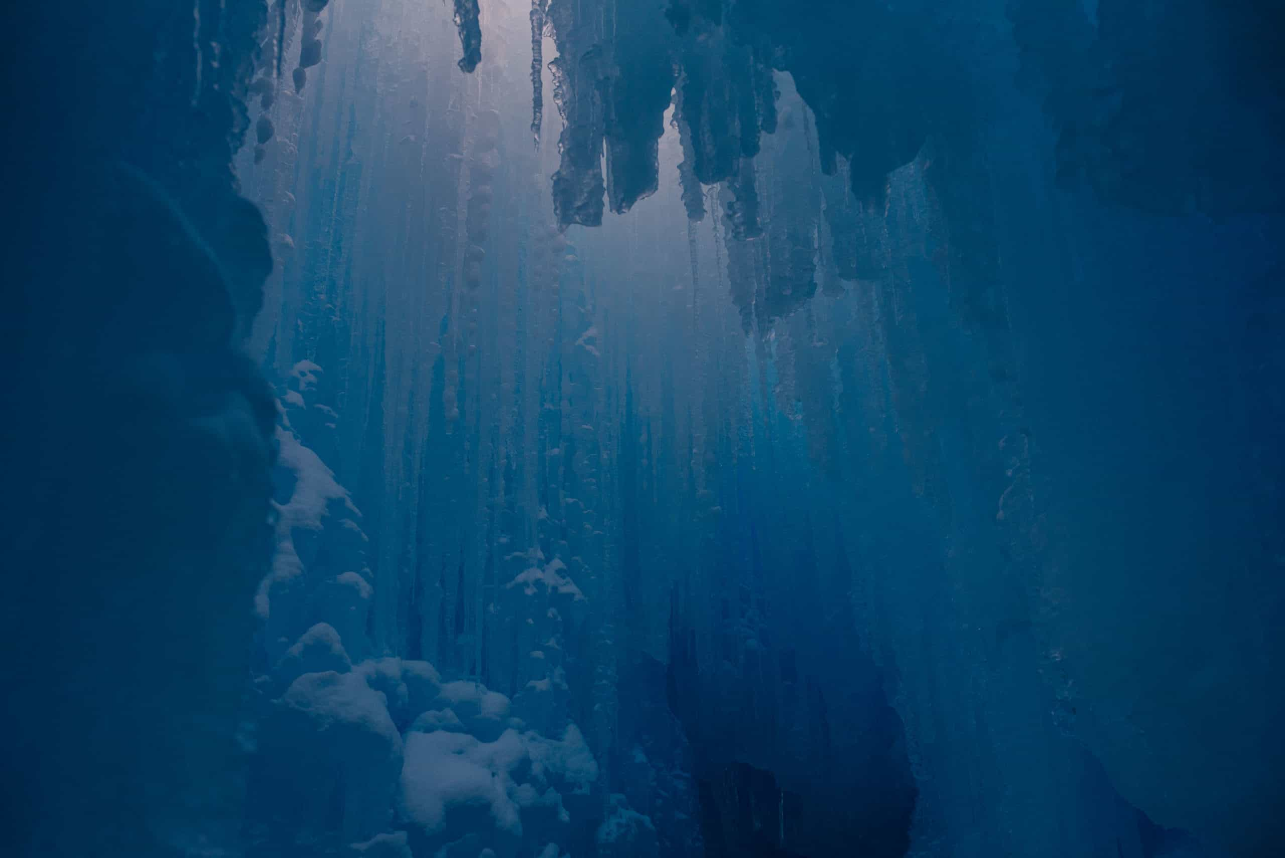 view of the ice castles with the light glowing through