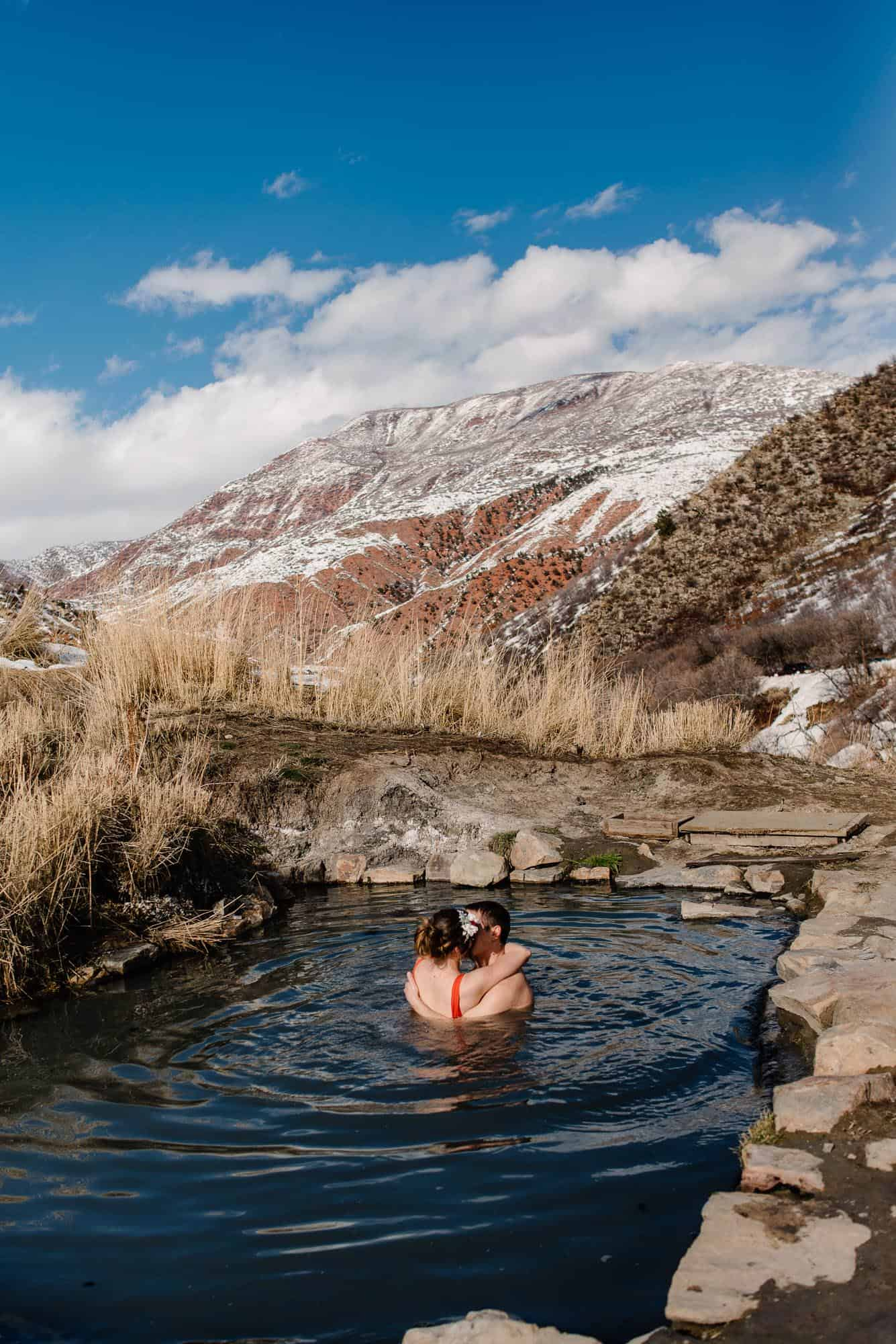 couple in a natural hot spring in the mountains