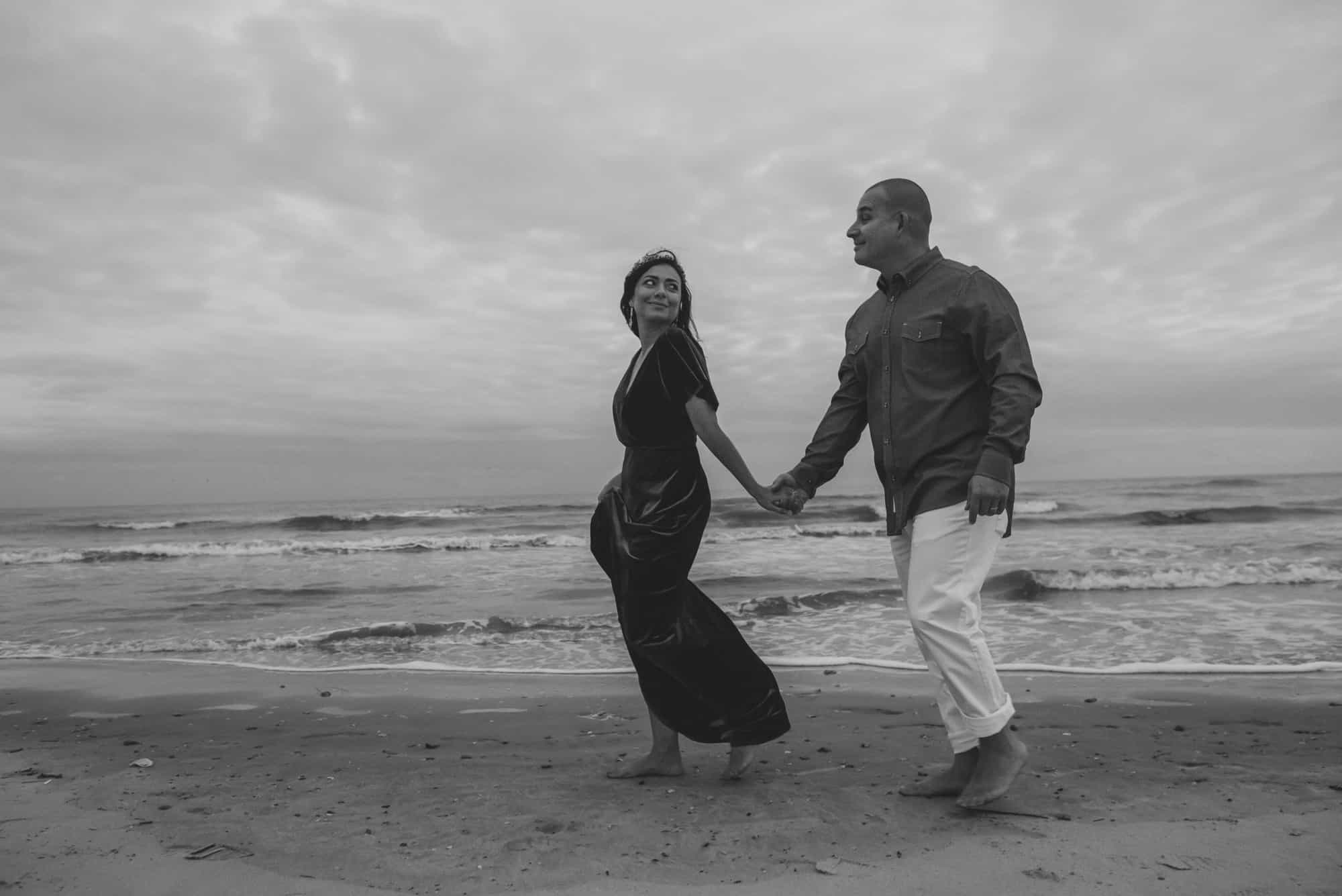 bride and groom walking on the beach during their wedding day