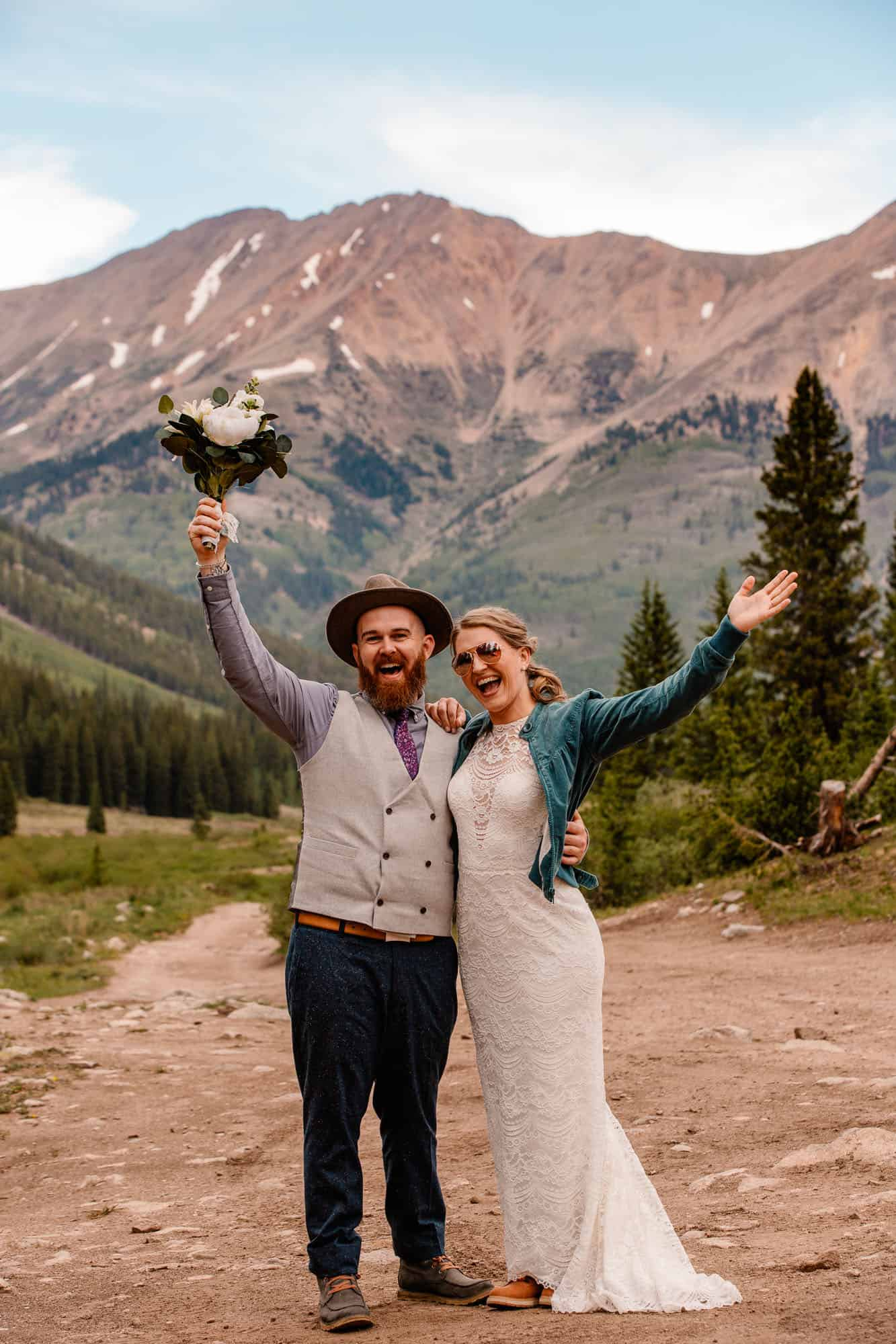 couple in an epic mountain location on wedding day