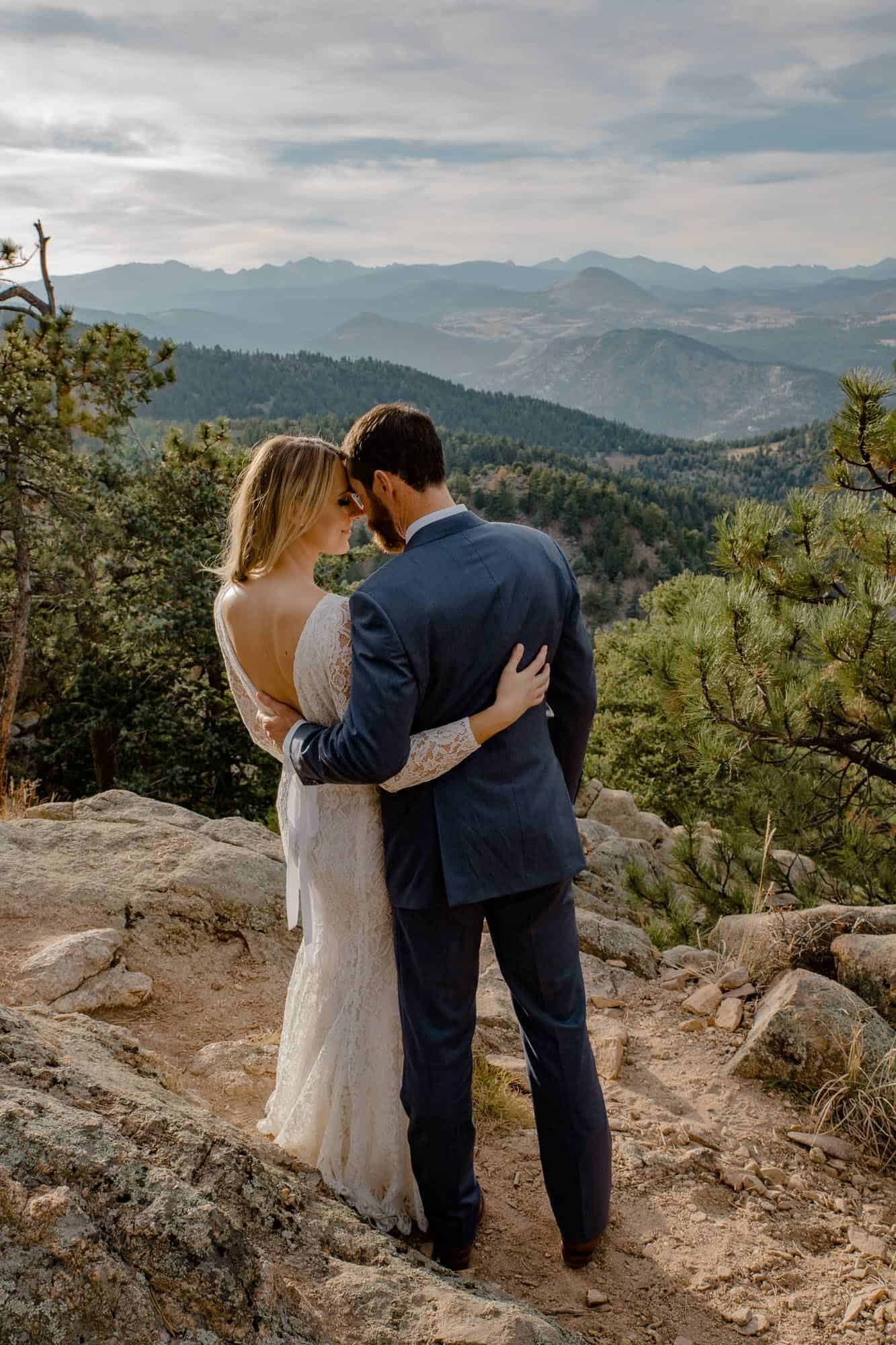couple standing with sweeping views in the background