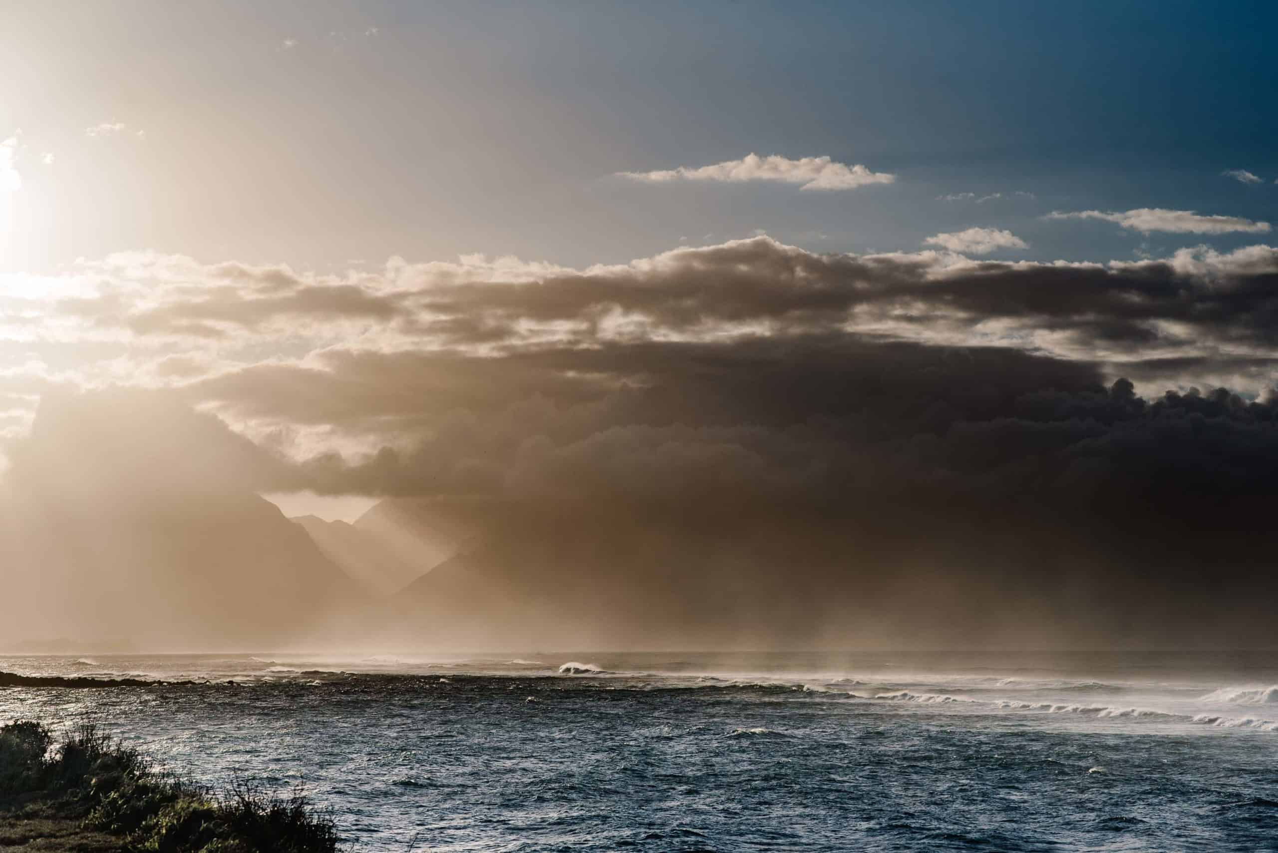 view of maui and Iao Valley as the sunsets behind the mountains on a winter day