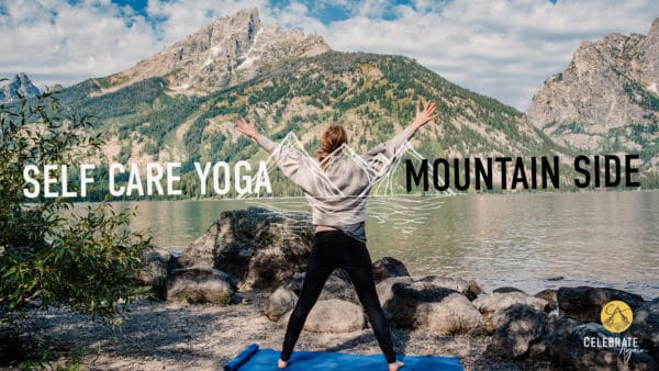 """female standing on a yoga mat in star pose near a mountain side with text that says """"self care yoga Mountain side yoga"""""""