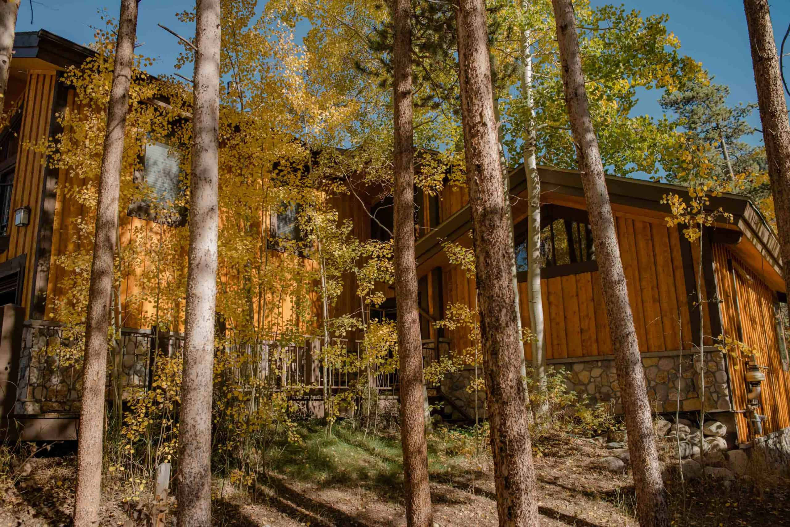 view of an airbnb wedding venue in Colorado as the aspen leaves are starting to turn colors