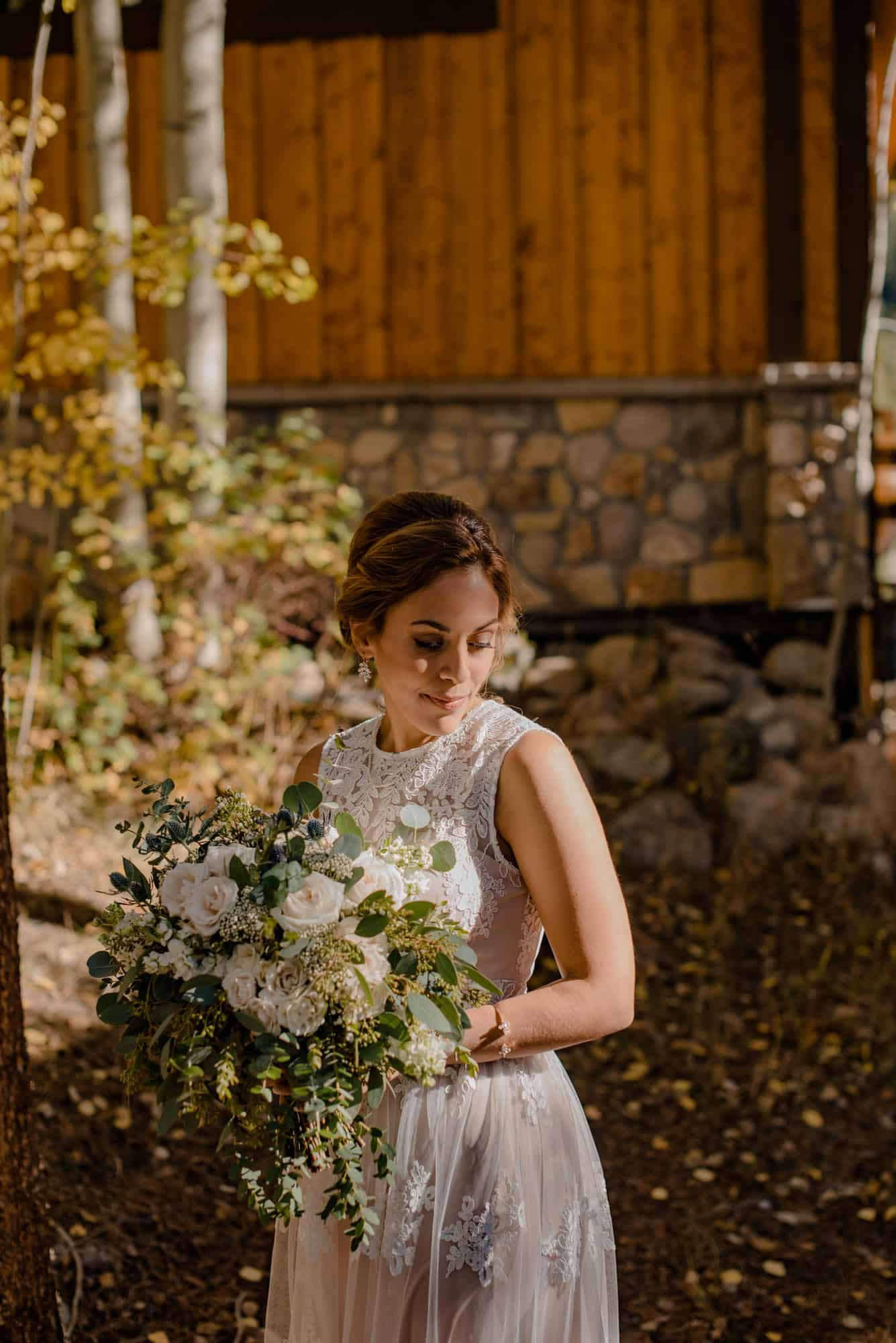 bride holding flowers outside her airbnb wedding venue Colorado