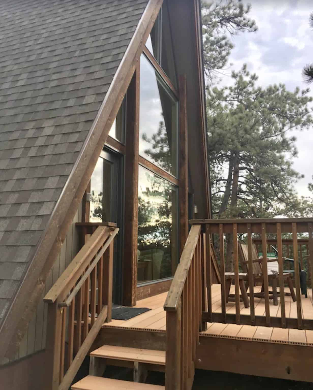 airbnb wedding venues colorado rustic a frame house view from outside the back forested patio