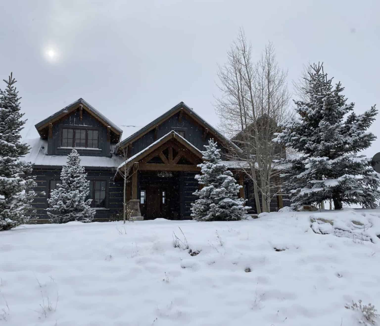 airbnb wedding venues colorado modern mountain cabin covered in snow