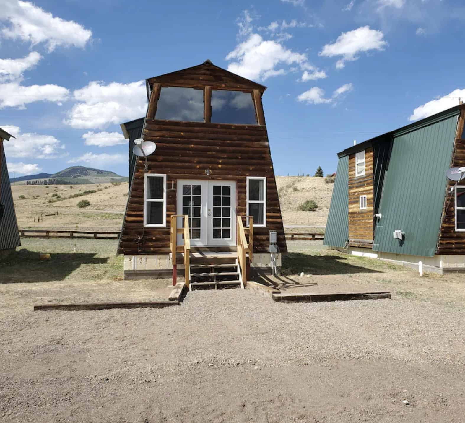 airbnb wedding venues colorado rustic a frame house view from outside and blue skies in the background