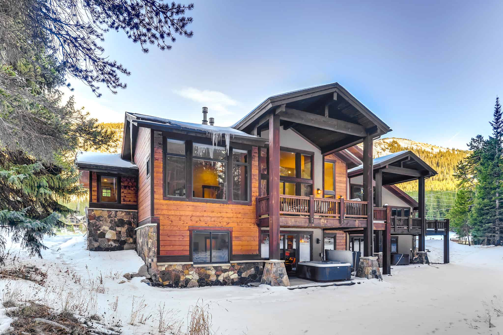 airbnb wedding venue Colorado a wooden cabin rental home with snow around and view of all the balconys