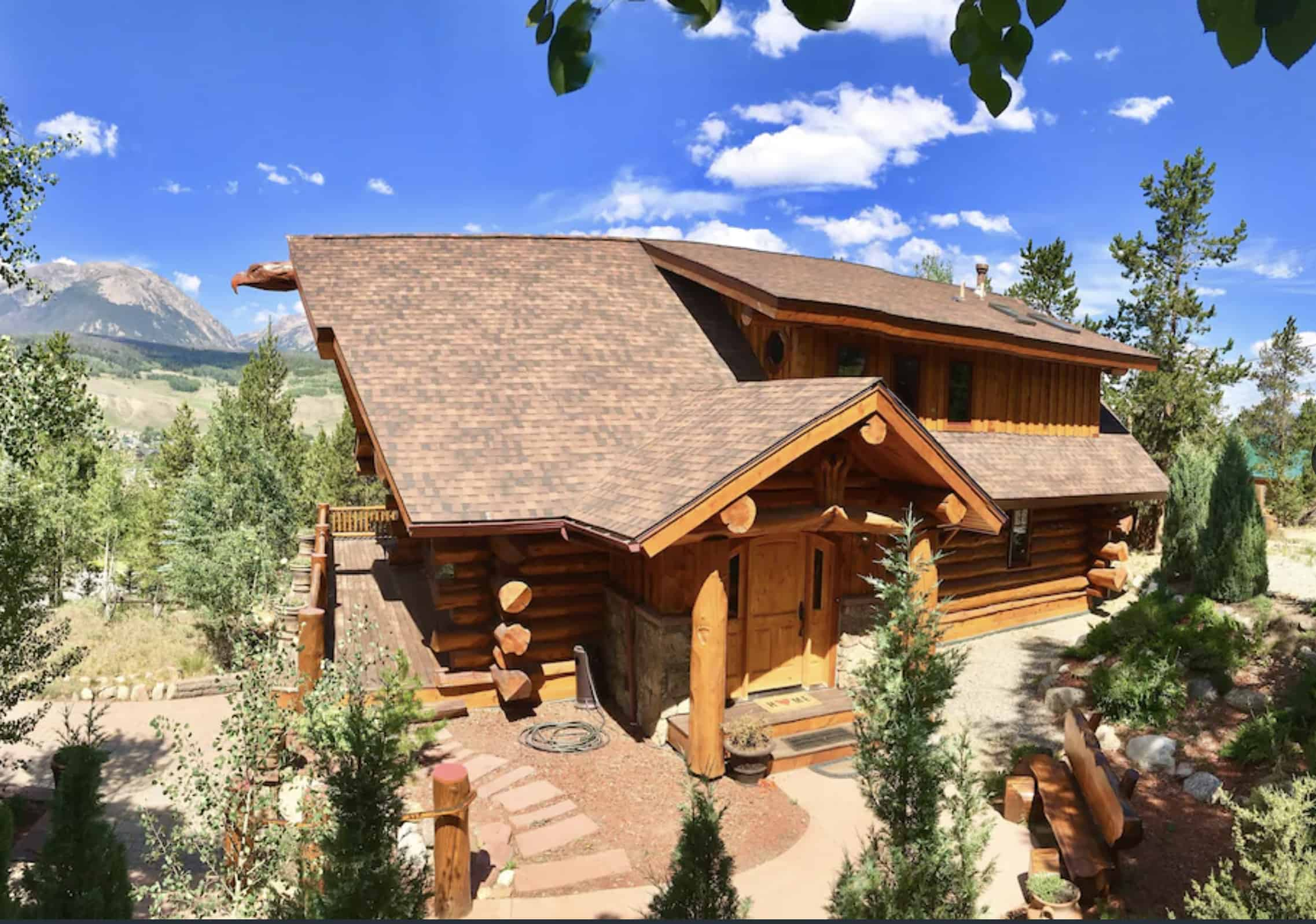 airbnb wedding venue Colorado a wooden cabin rental home with the view of summit county mountains in the background